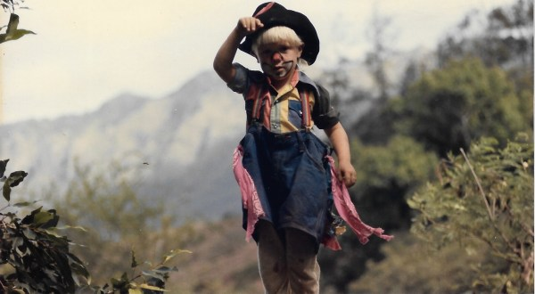 Shane dressed as a clown age 3 hiking the ranch